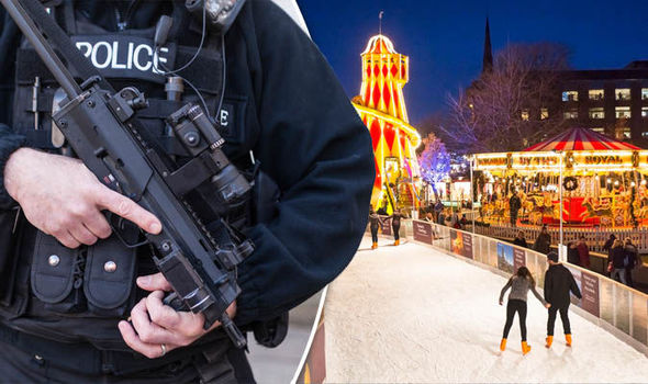 Armed police stopping cars and pedestrians in Christmas Market security crackdown
